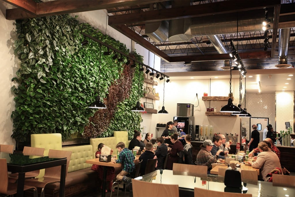 Diners enjoy indoor tropical living walls