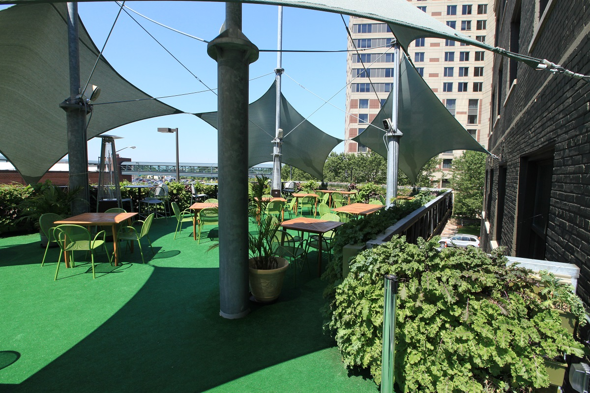 The patio at The BOB in Grand Rapids, MI featuring their herb and leafy green garden walls.