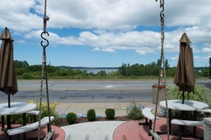 View of Muskegon Lake from swing on patio of flower and gift shop.