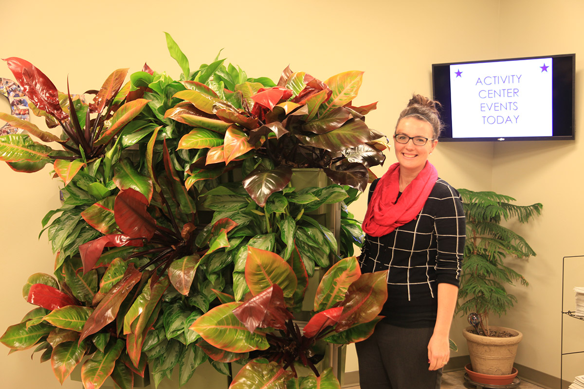 Four Pointes Activities Director Jessie Riley and Indoor Demonstration Green Wall on Wheels