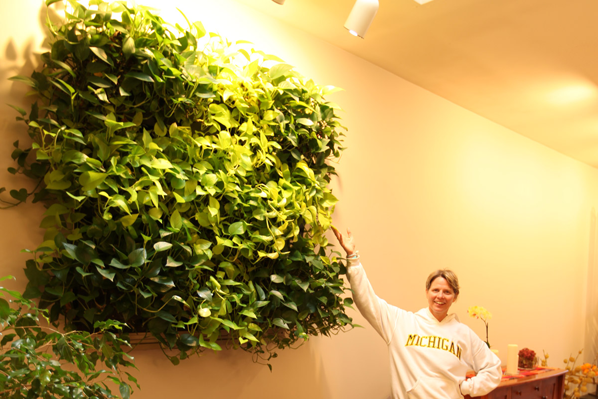 A proud residential owner shows her green wall.