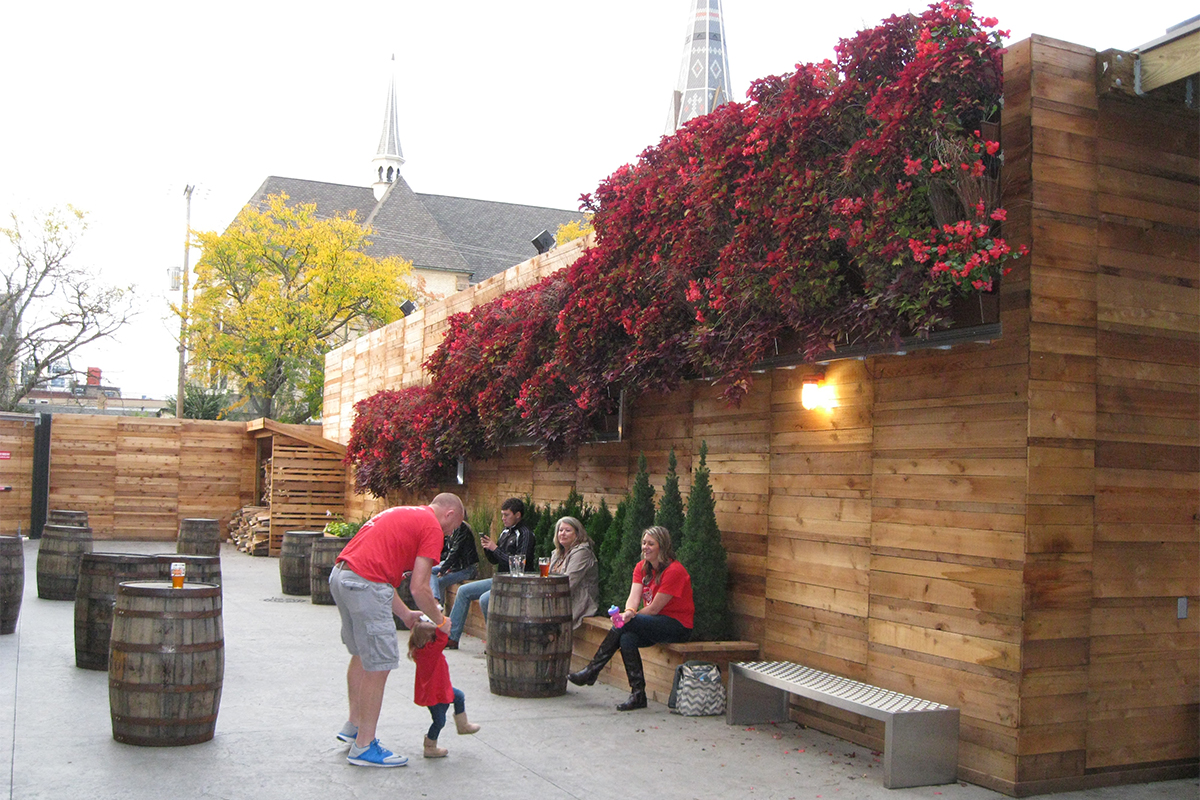 Family enjoys outdoor seating and socializing area at New Holland Brewing's Knickerbocker brewpub in Grand Rapids, Michigan.