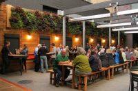 Patrons of New Holland Brewery's Knickerbocker enjoy the outdoor beer garden complete with vertical garden.