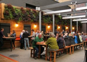 Patrons of New Holland Brewery's Knickerbocker enjoy the outdoor beer garden complete with vertical garden.