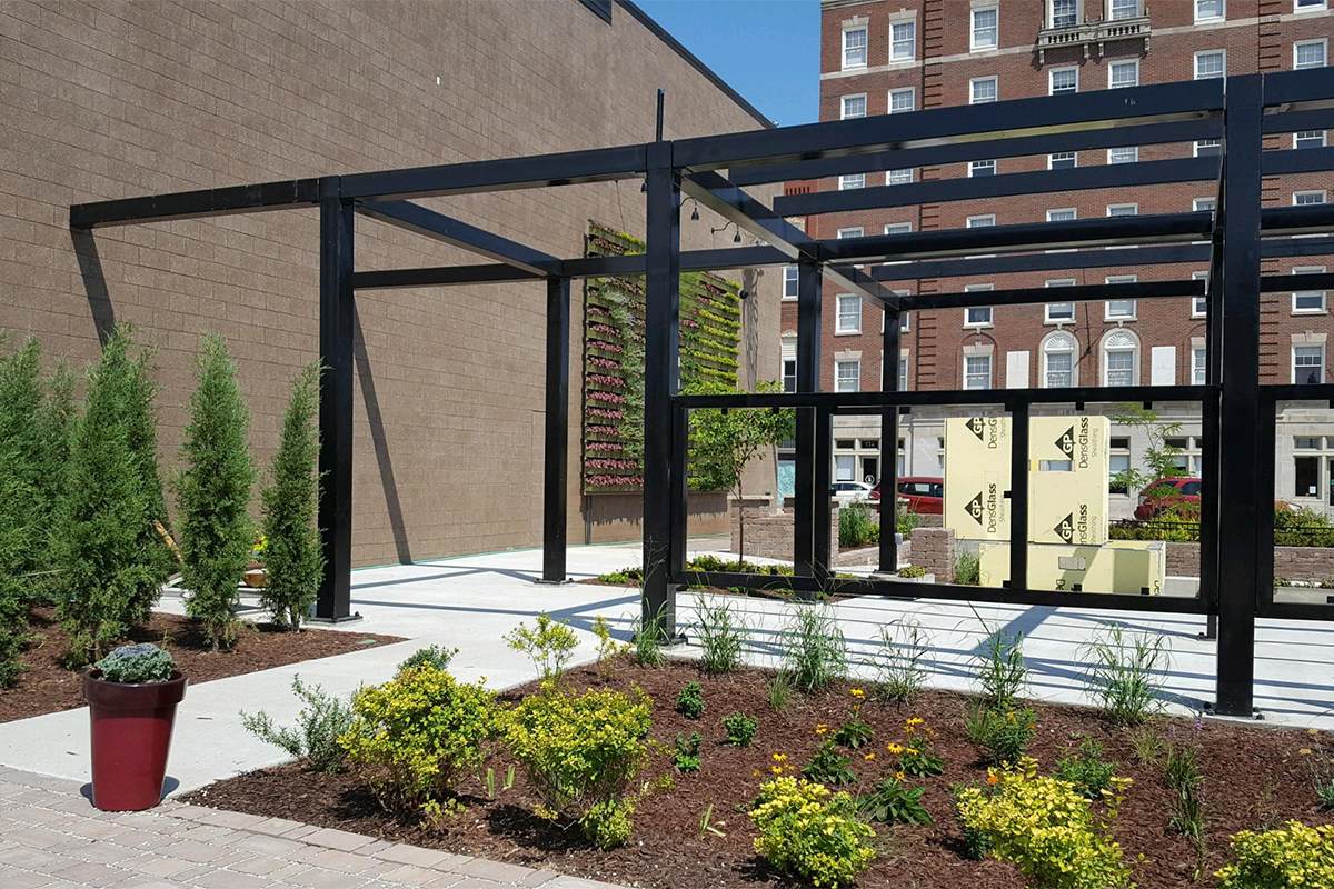 "Green wall, newly planted, is a focal point in the community ""pocket park"" at Kibbey Building."