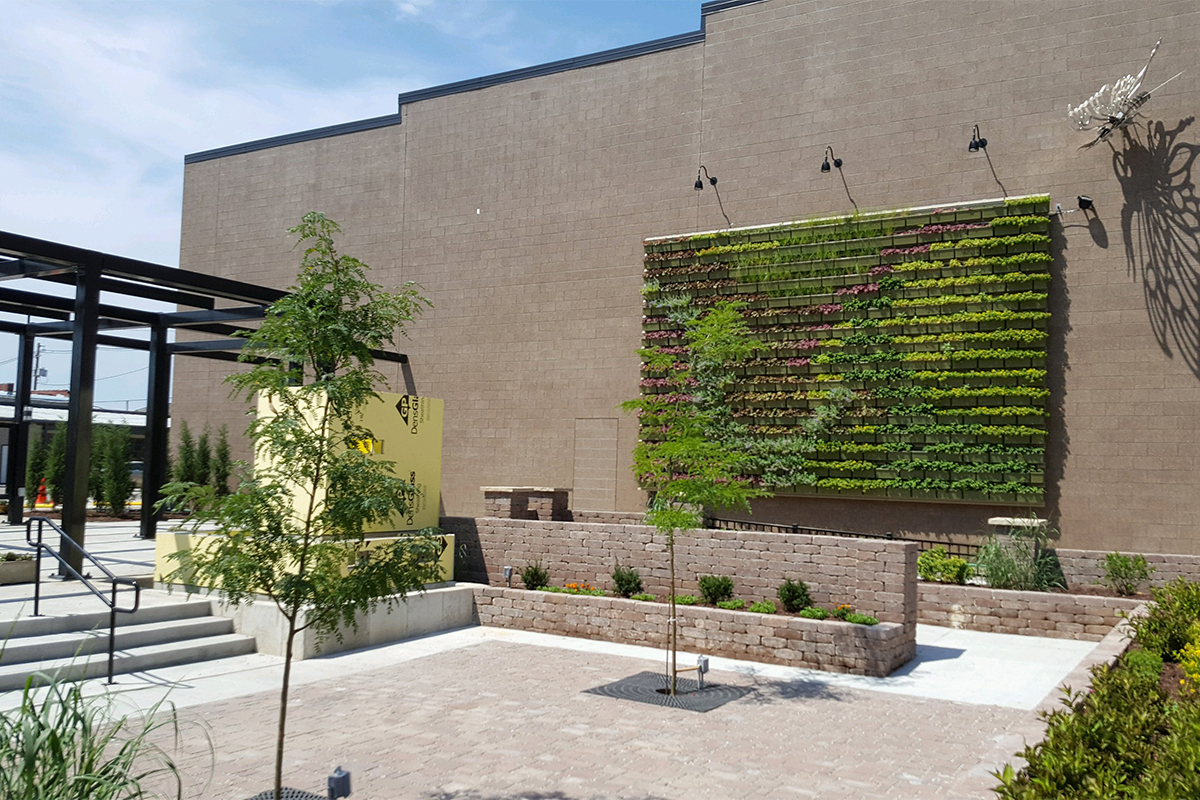 Gallery Garden Pocket Park Living Wall with newly placed perennial plants.
