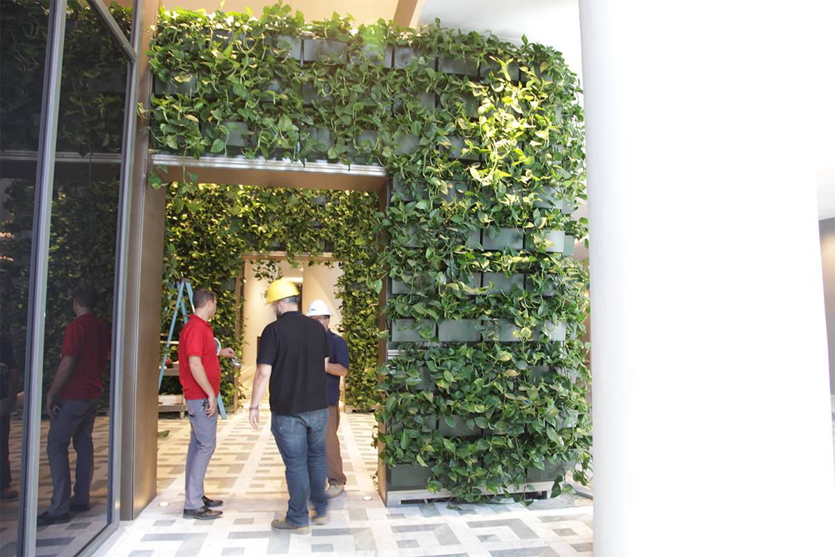 Installers put the finishing touches on the newly installed archway living walls at the entrance of the SLS Lux in Miami, FL.