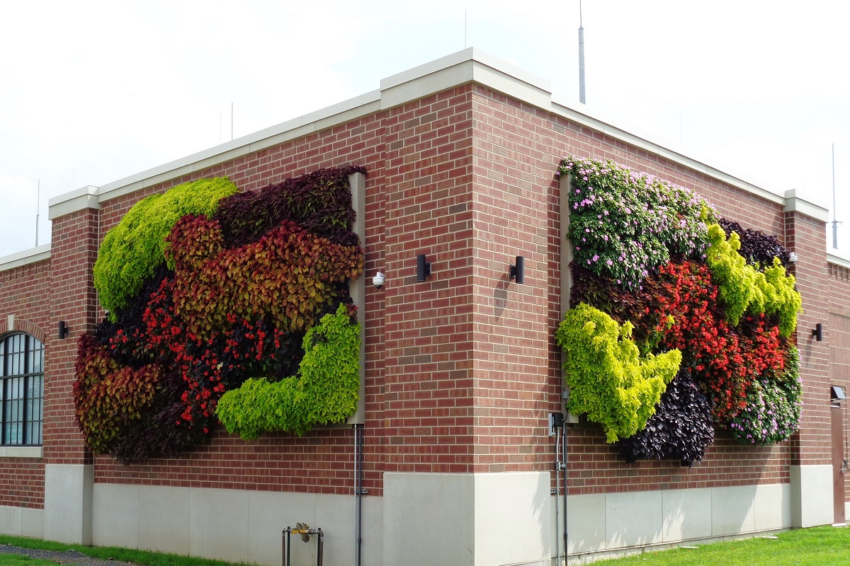 Lansing BWL brick building with two living walls filled with bright annuals