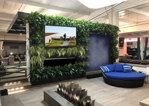 LiveWall green wall feature with fireplace, waterfall, and television