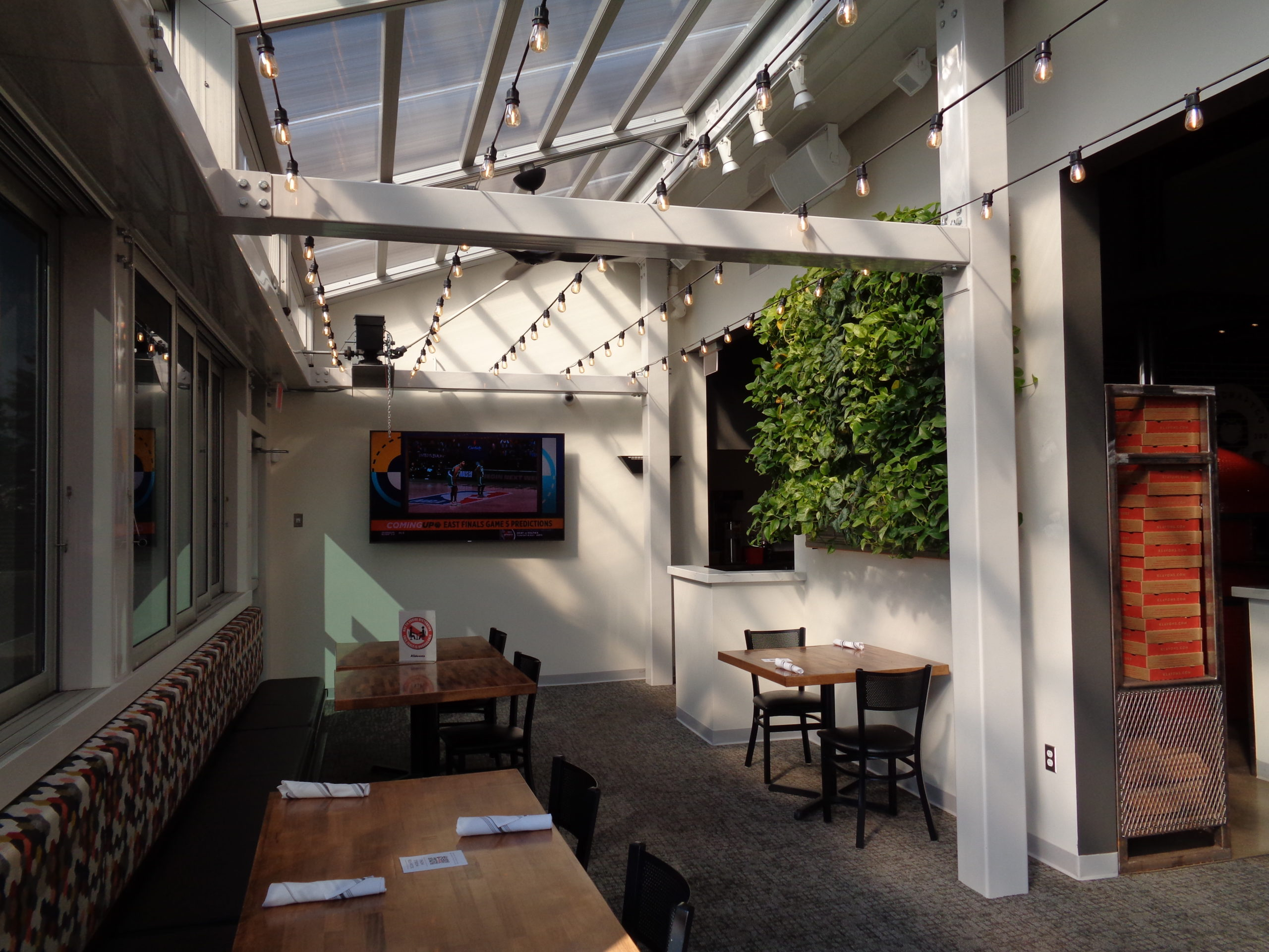 Tropical plants in Klavon Pizzeria's living wall