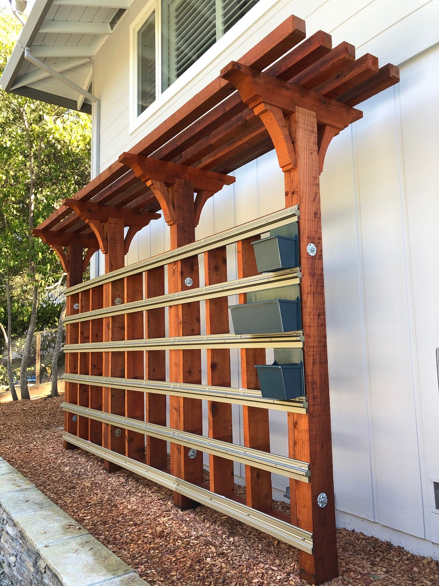 LiveWall fence application using a red wood frame and Cool Blue planter boxes